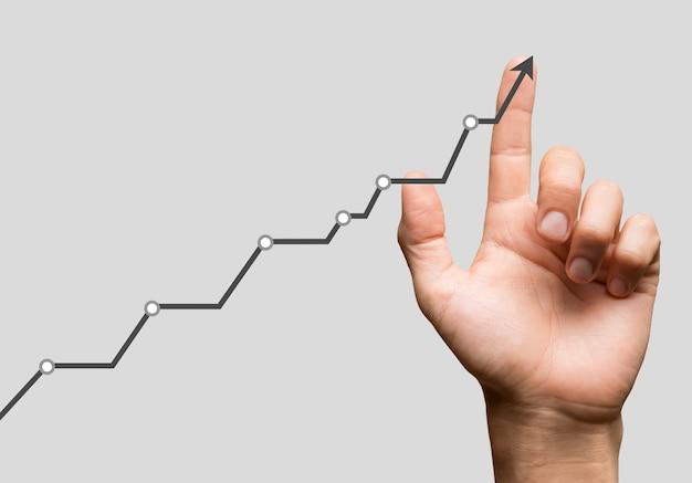 Biznesmen i rosnąca linia, symbolizują rosnące umiejętności