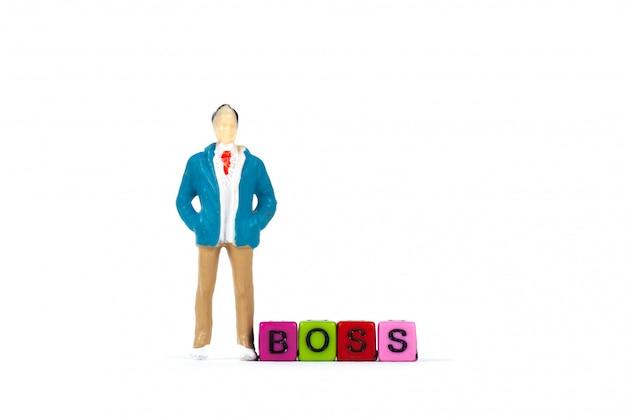 Biznesmen, kierownik lub szef z tekstem boss