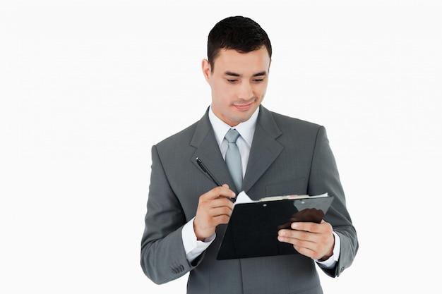 Biznesmen pisania w schowku