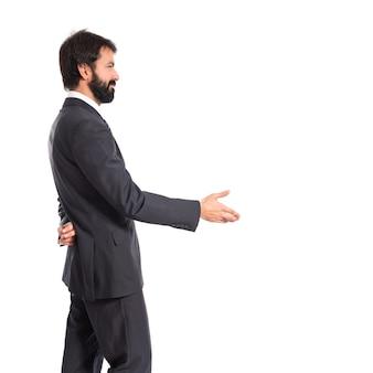 Biznesmen podejmowania transakcji nad pojedyncze bia? ym tle