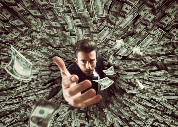 Biznesmen połknięty przez czarną dziurę pieniędzy. koncepcja porażki