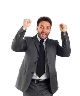 Biznesmen raduje się z rękami do góry