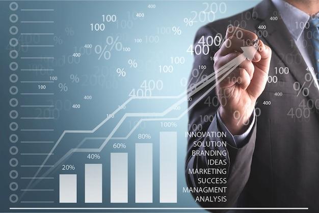 Biznesmen ręka punkt wykres wzrostu