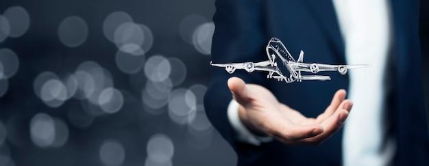 Biznesmen ręka samolotem
