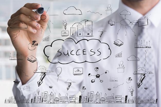 Biznesmen rysunek z kluczy do sukcesu