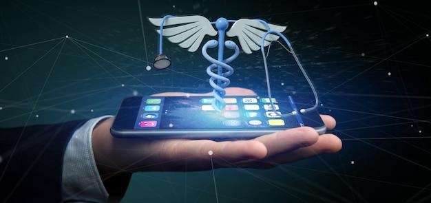Biznesmen trzyma 3d redering medycznych cadaceus i stetoskop