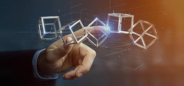 Biznesmen trzyma 3d renderingu blockchain sześcian