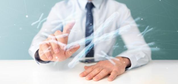 Biznesmen trzyma grupę chromosom z dna inside odizolowywającym