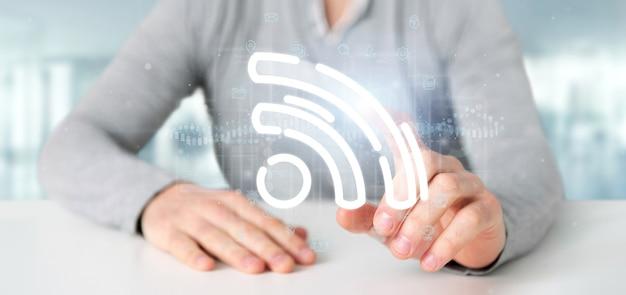Biznesmen trzyma ikonę wifi z danymi dookoła