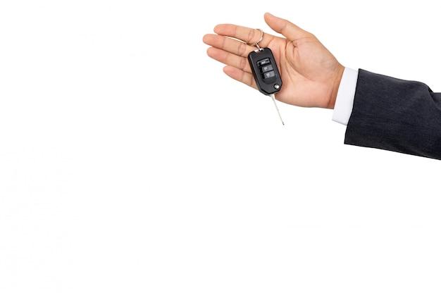Biznesmen trzyma kluczyk