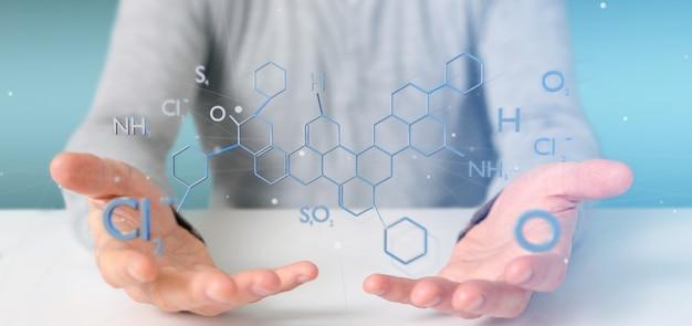 Biznesmen trzyma strukturę molekuły na białym tle