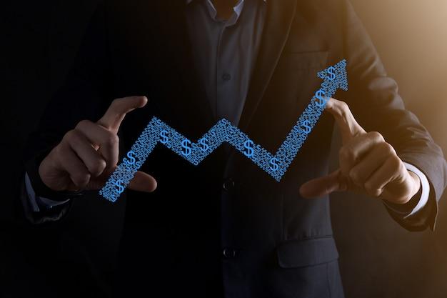 Biznesmen trzymaj rysunek na ekranie rosnącym wykresie, strzałka ikony dodatniego wzrostu. wskazując na wykres kreatywnego biznesu strzałkami w górę. koncepcja finansowa, rozwój biznesu.
