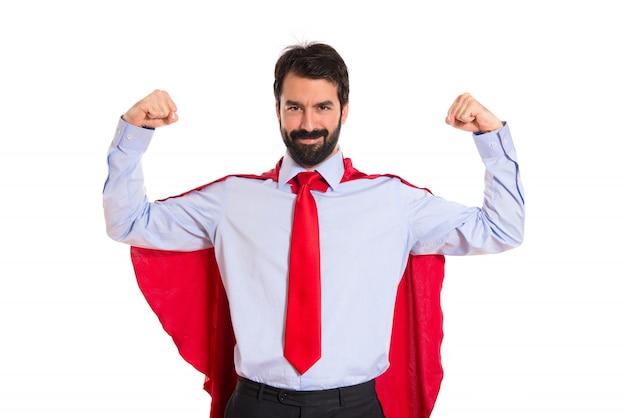 Biznesmen ubrany jak superhero z kciukiem do góry