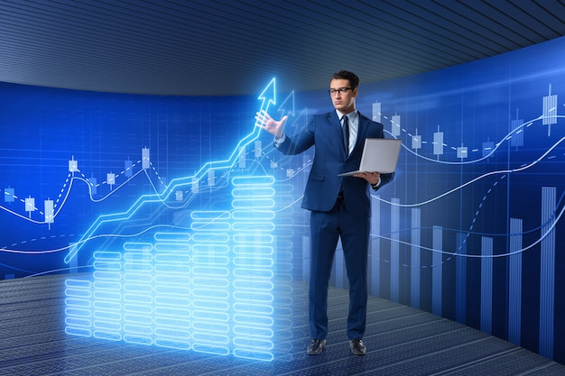 Biznesmen w giełdowym handlu pojęciu