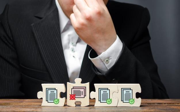 Biznesmen w nieładzie z powodu niemożności ukończenia zbierania zezwoleń na dalszą pracę