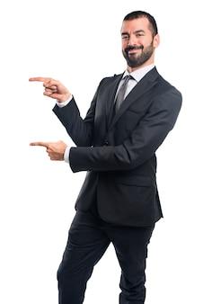 Biznesmen wskazując na boczne