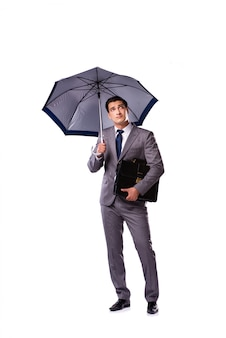 Biznesmen z parasolem odizolowywającym na bielu