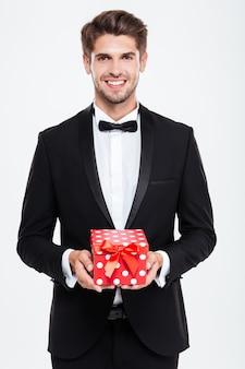Biznesmen z prezentem. wspaniały portret