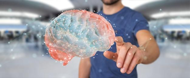 Biznesmen za pomocą cyfrowej projekcji 3d ludzkiego mózgu
