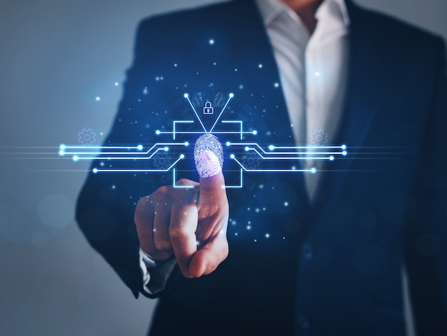 Biznesmen za pomocą identyfikacji odcisków palców w celu uzyskania dostępu do osobistych danych finansowych. koncepcja technologii innowacji