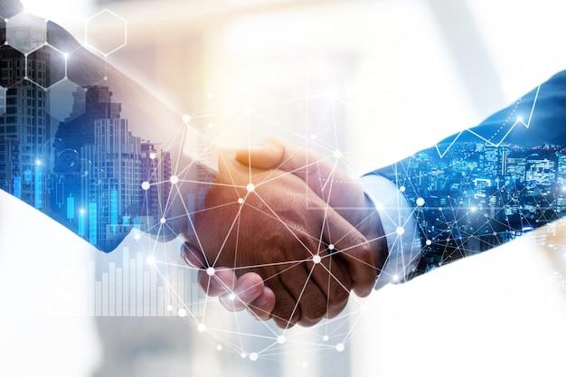 Biznesmenów uścisk dłoni inwestora z efektem globalnego połączenia sieciowego i diagramu wykresu