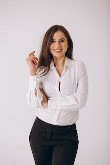 Biznesowa kobieta w białej koszula odizolowywającej na białym tle