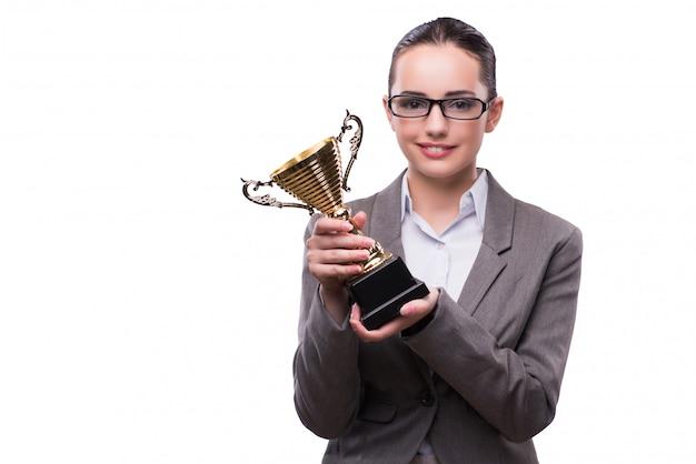 Bizneswoman z filiżanki trofeum odizolowywającym na bielu