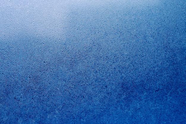 Błękitna abstrakt woda opuszcza tło