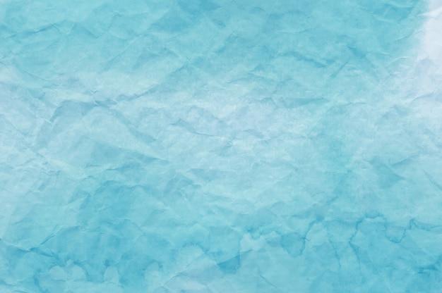 Błękitna akwarela na zmiętym papierze pożytecznie jako tło