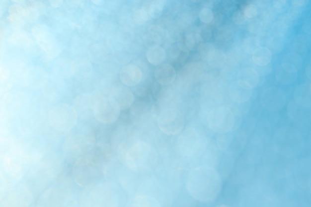Błękitna bokeh abstrakta tekstura. niewyraźne jasne światło w nocy.