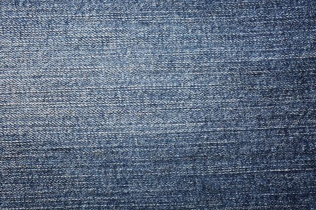 Błękitna drelichowa cajg tekstura i tło.