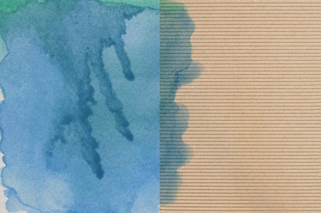 Błękitna i zielona akwarela na papierowym tle