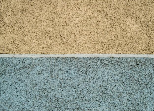 Błękitna i żółta szorstka abstrakcjonistyczna sztukateryjna tekstura dla tła