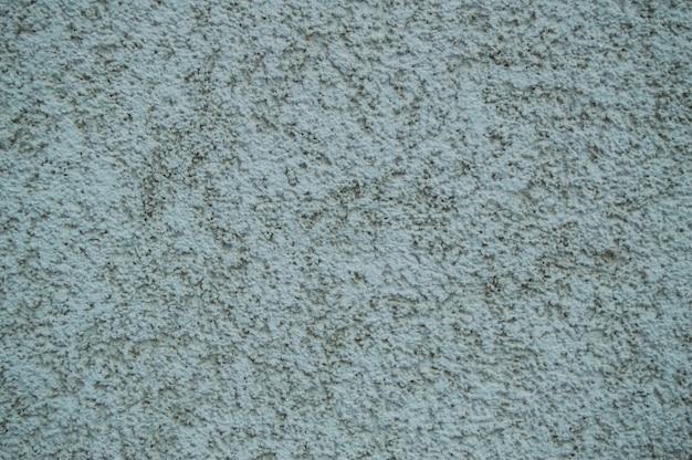 Błękitna szorstka abstrakcjonistyczna sztukateryjna tekstura dla tła