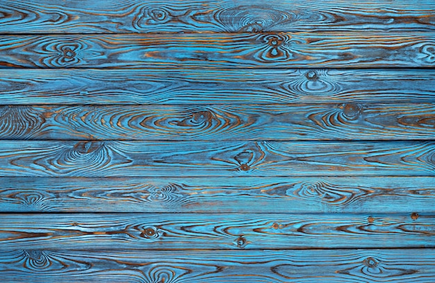 Błękitne drewniane deski, stara i grunge błękitna barwiona drewniana tekstura