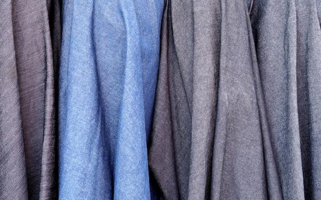 Błękitnej szarości tkaniny klasyczny abstrakcjonistyczny tło.