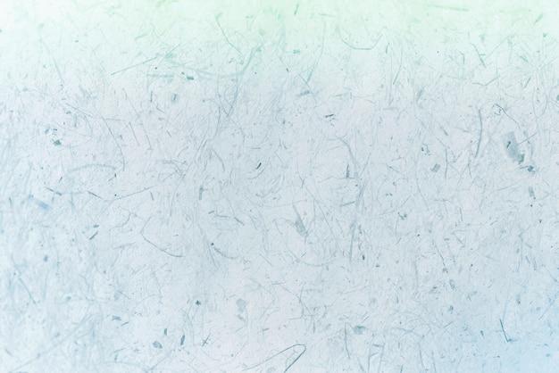 Błękitny i zielony papier textured tło