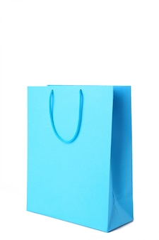Błękitny torba na zakupy odizolowywający na białym tle