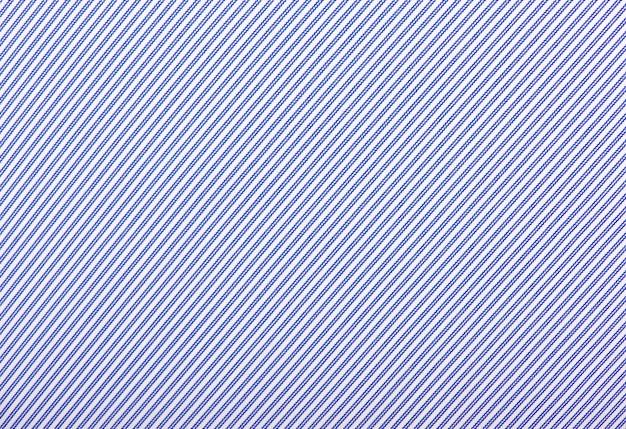 Bliska białe i niebieskie paski włókienniczych tle.