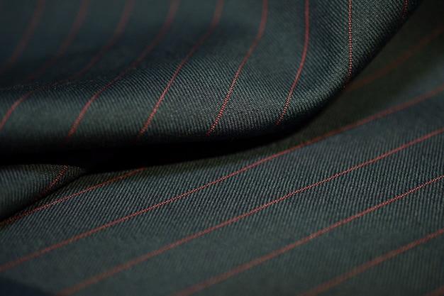 Bliska ciemnoszare tkaniny garnitur z czerwoną linią taśmy, photoshoot przez głębia ostrości dla obiektu