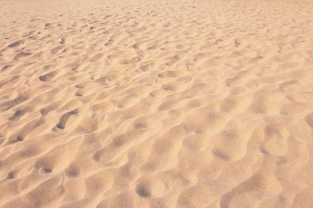 Bliska piasek tekstury wzór tła plaży latem