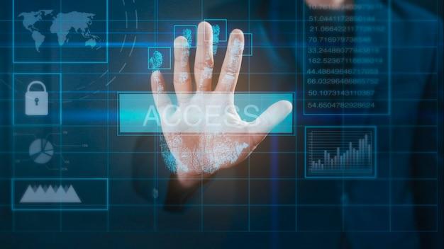 Bliska ręka biznesmen dotyka interfejsu monitora komputera, tożsamości biometrycznej odcisków palców i zatwierdzenia.