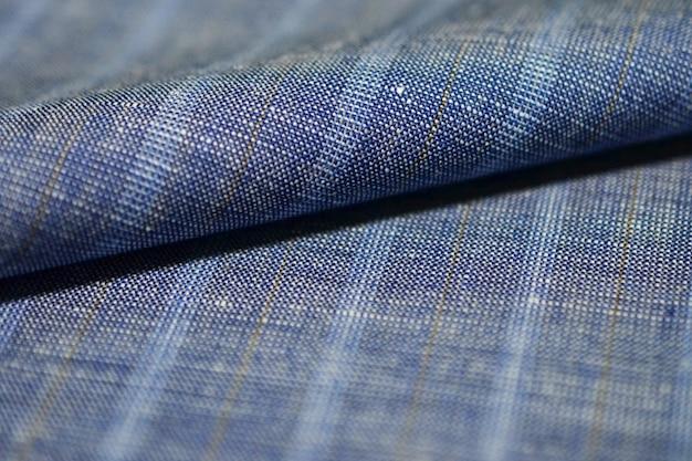 Bliska rola denim tkaniny garnitur, photoshoot przez głębia ostrości dla obiektu