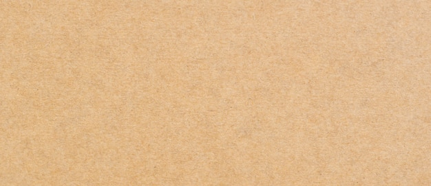 Bliska tekstura i tło brązowego papieru z miejscem na kopię