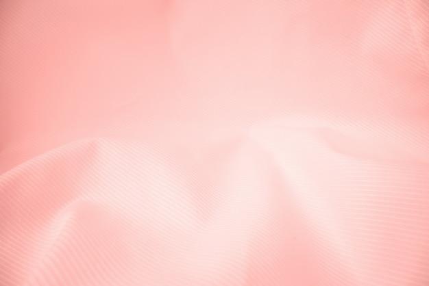 Błyszcząca bieżąca sukienna tekstura w makro strzale.