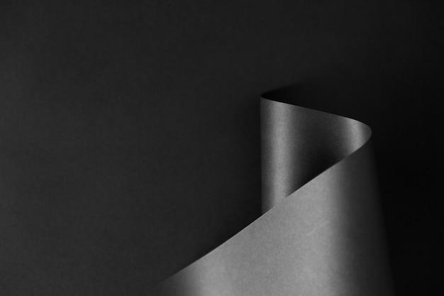 Błyszcząca fala czarno-biały papier monochromatyczny na ciemnym tle