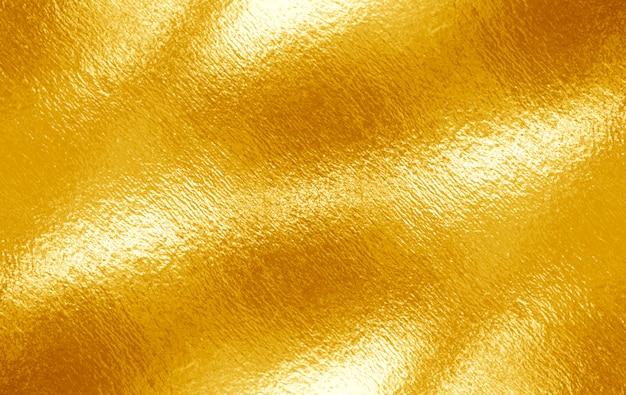 Błyszcząca żółta liść złota folia tekstura