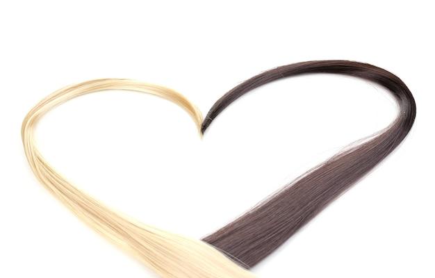 Błyszczące blond i brązowe włosy na białym tle