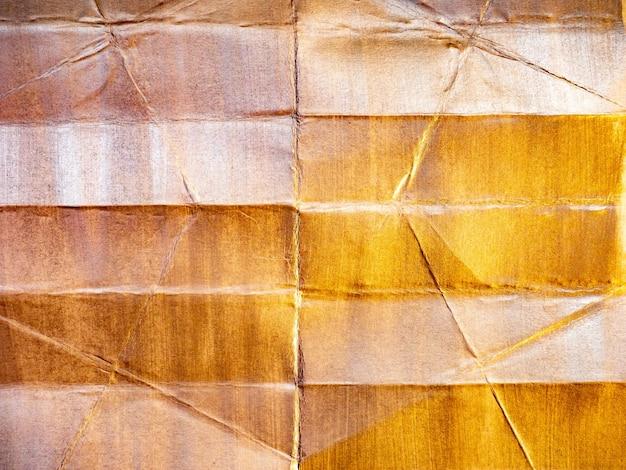 Błyszczące tło zgrywanie i zmięty papier z pociągnięciami pędzla i teksturą farby.