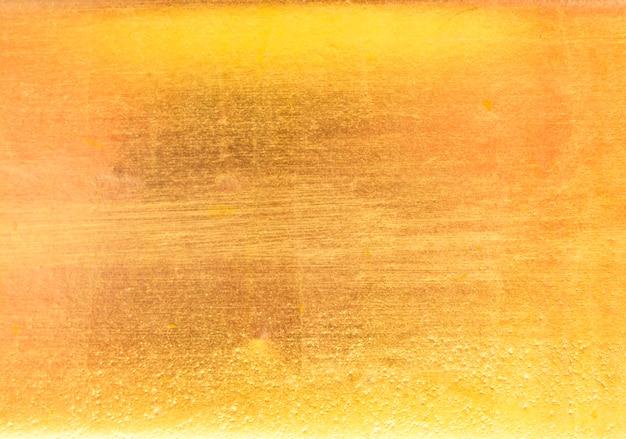 Błyszczący żółty liść złota tekstura